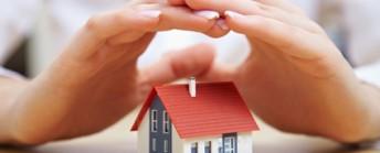 Hände schützen Haus
